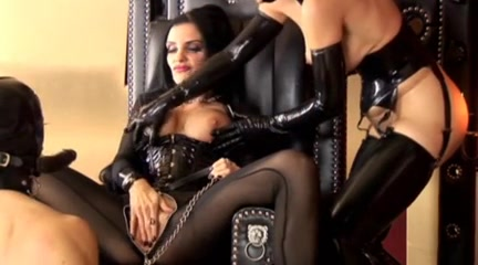 Astonishing dominatrices upon latex agony their menial