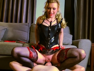 Mature mistress fucks her male slave's butt